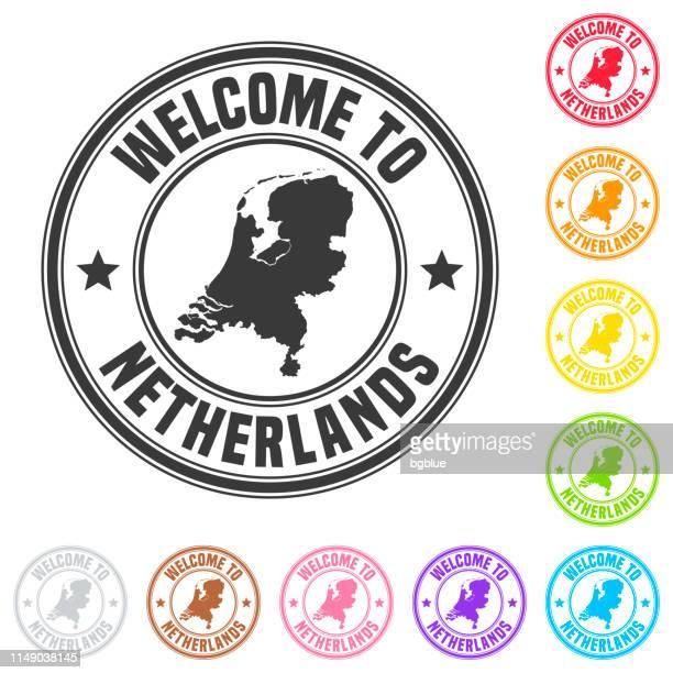stockillustraties, clipart, cartoons en iconen met welkom bij nederland stempel-kleurrijke badges op witte achtergrond - benelux
