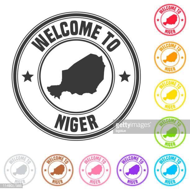 ilustrações, clipart, desenhos animados e ícones de boa vinda ao selo de niger-emblemas coloridos no fundo branco - níger