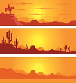 Western Desert Scene at Sunrise with Cowboy