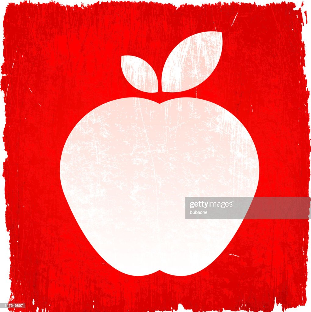 White apple on red grunge background with red apples bedside