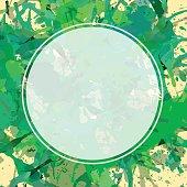 White circle over artistic paint splashes