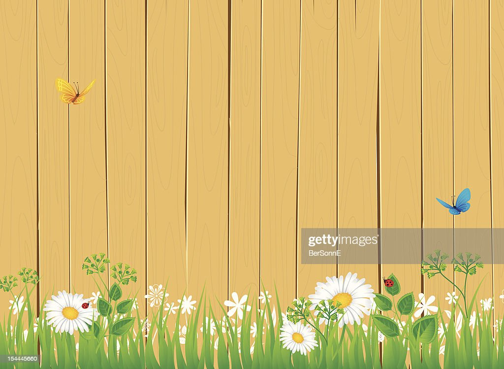 White fence with grass