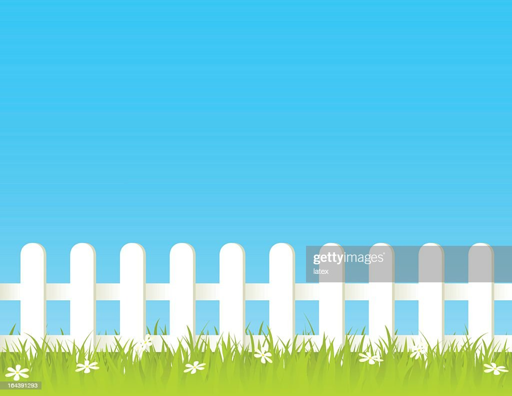 White fence with green and beautiful garden