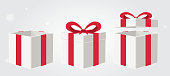 white gift box with red ribbin