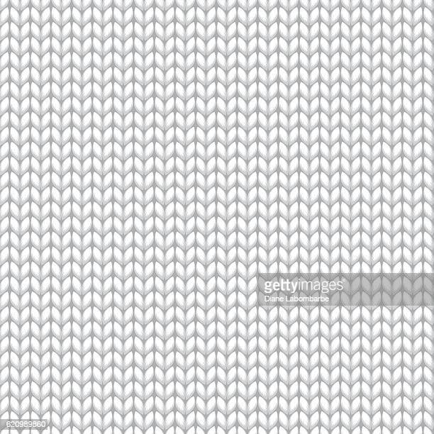 white knitted sweater material seamless pattern - jumper stock illustrations