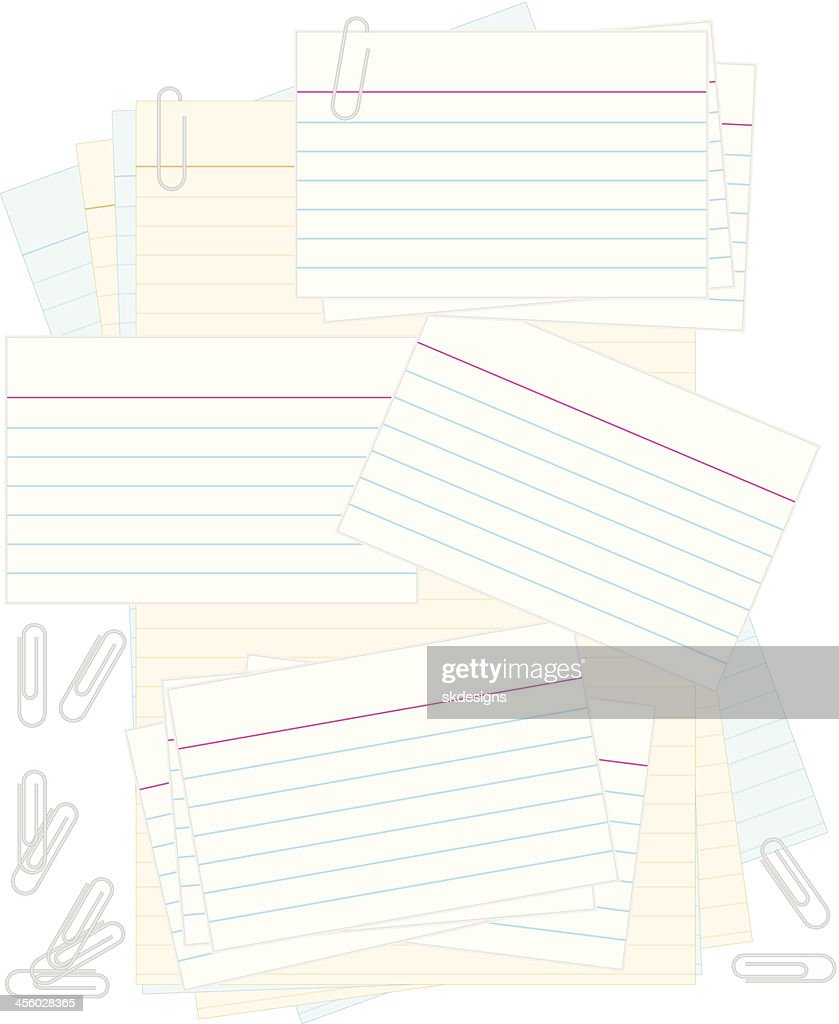 white note or recipe cards paper clips colored notepad background