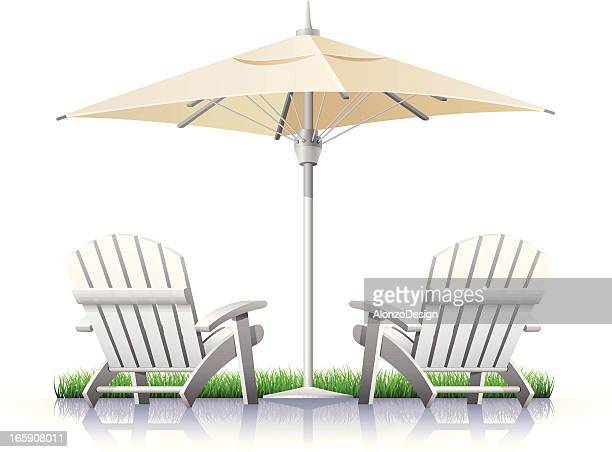 White Outdoor Chairs and Parasol
