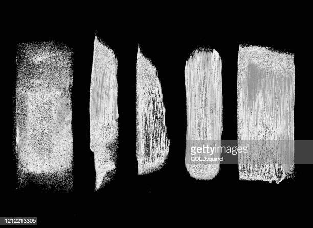 white paint and paint roller traces on black paper background - vector illustration with visible dirties dots spots lines and uneven irregular distribution of paint - handmade unfinished spontaneous graphic design - irregular texturizado stock illustrations