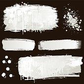 White paint splatter on black background