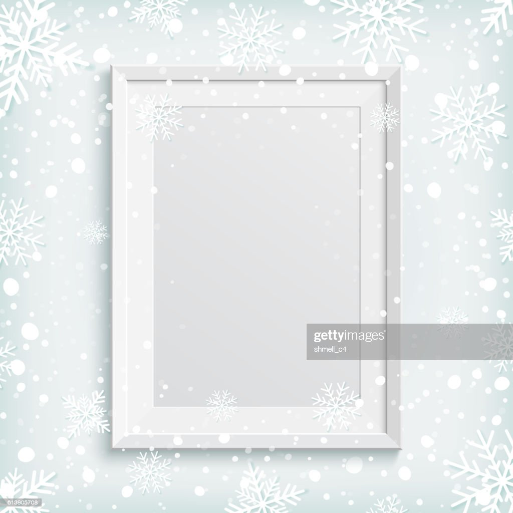 White picture frame on winter background.