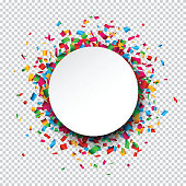 White round paper note over confetti