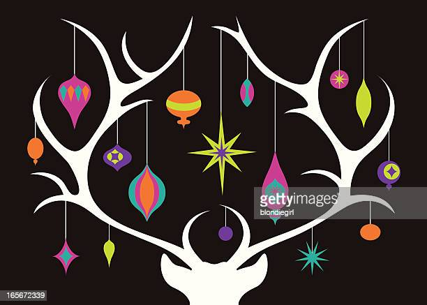 White silhouette of reindeer antlers with Christmas balls