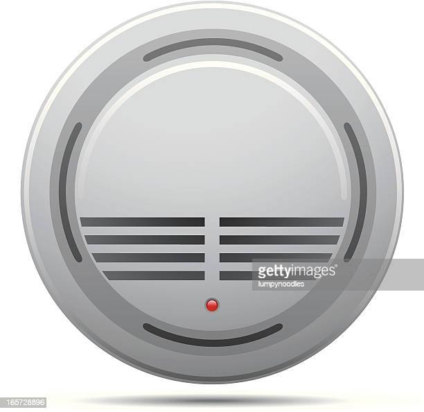 A white smoke detector on a white background