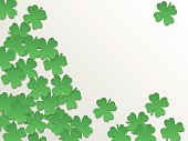 White St. Patrick day background with clover four-leaf flat green paper cut leaves. Vector simple design