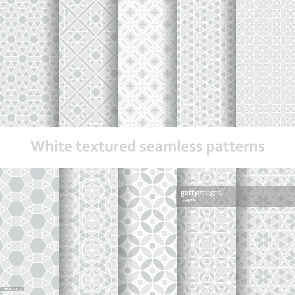 White textured seamless patterns set