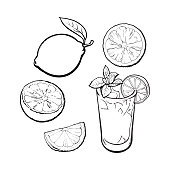 Whole, half, quarter lime and glass of lemonade with ice