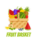 Wicker basket full of fruits gooseberry, garnet, lemon, orange, apple, banana, grapes, pineapple, strawberry, watermelon. Agriculture garden farming concept