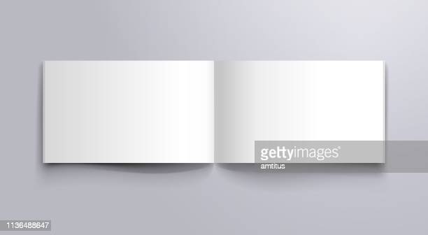 wide book open pages mockup - horizontal stock illustrations