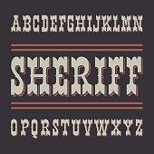 Wild West style font on dark background.