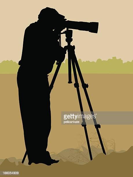 wildlife photographer - camera tripod stock illustrations, clip art, cartoons, & icons