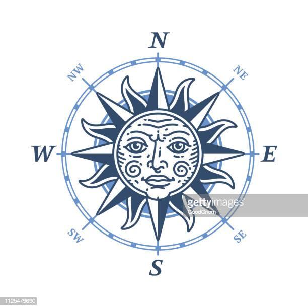 ilustraciones, imágenes clip art, dibujos animados e iconos de stock de emblema de la rosa de los vientos - sol en la cara