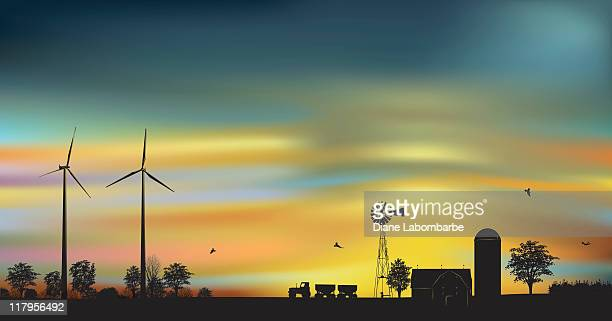 Wind Turbines on a farm at dawn