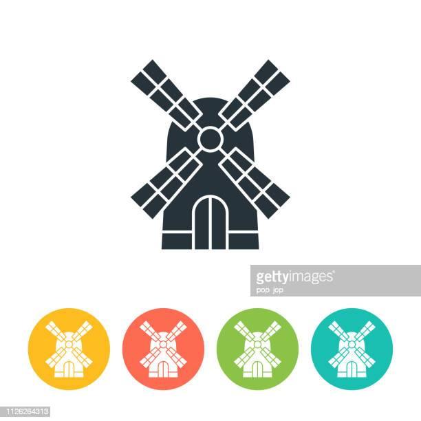 ilustraciones, imágenes clip art, dibujos animados e iconos de stock de icono plano molino de viento - ilustración de color - molino de viento