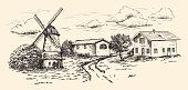 windmill, village houses and farmland