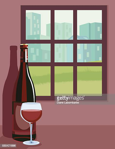 Wine Bottle and Wineglass On A Counter