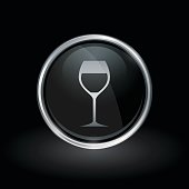 Wine glass icon inside round silver and black emblem