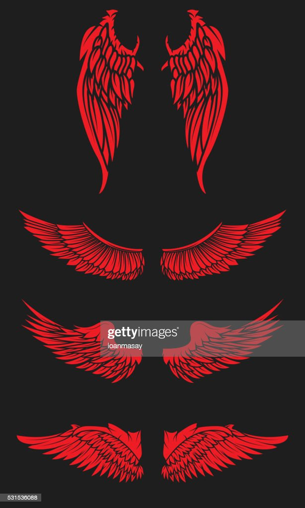 Wings set isolated on dark background. Design element for emblem