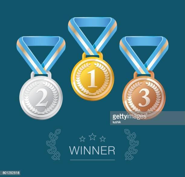 Winner medals isolated on dark blue