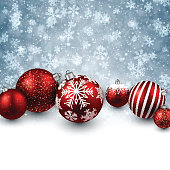 Winter background with red christmas balls.