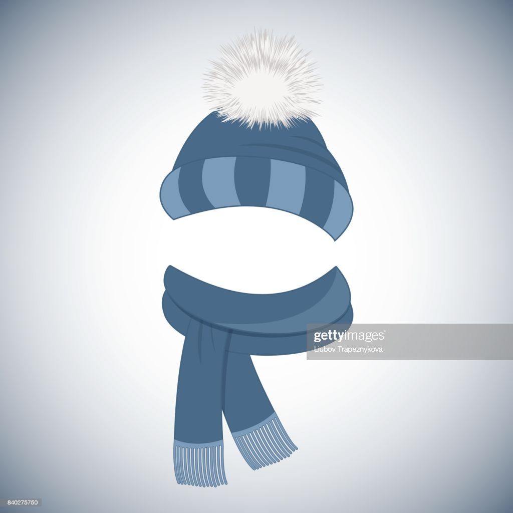 Winter blue cap with a pompom and a scarf with fringe.