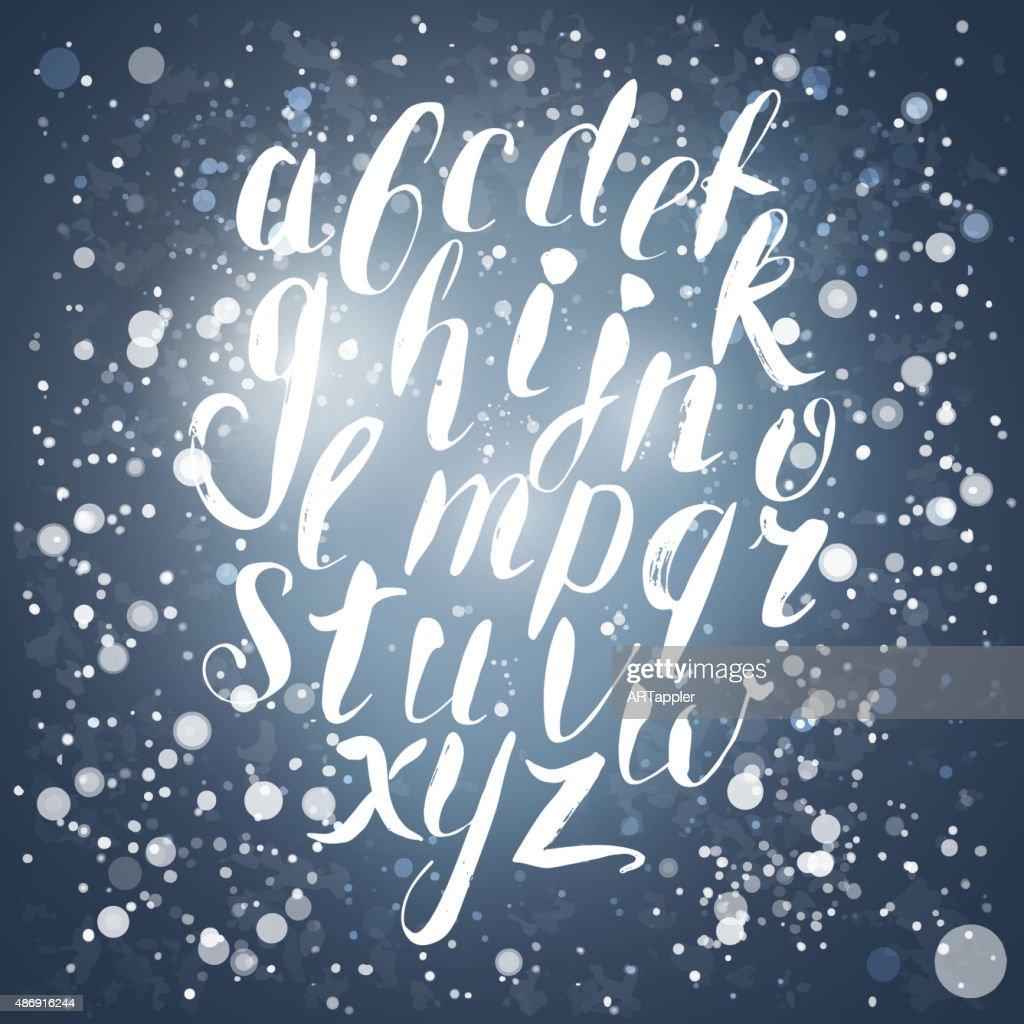 Winter calligraphy english alphabet with snow