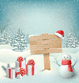 Winter Christmas Background with Signpost Snowman and Gift Boxes