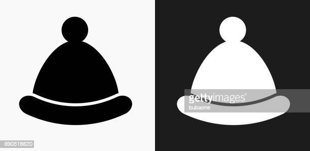 Winter Hat Icon on Black and White Vector Backgrounds