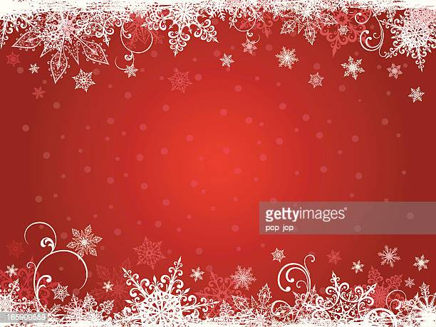Winter holidays background in white snowflakes and red