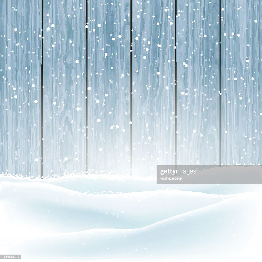 Winter snow on wood background