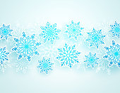 Winter vector background with falling snowflakes of different shapes