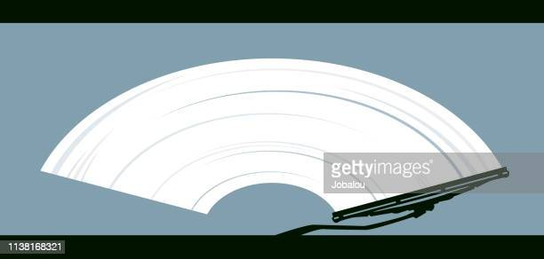 wiper cleans dirty glass - close up stock illustrations