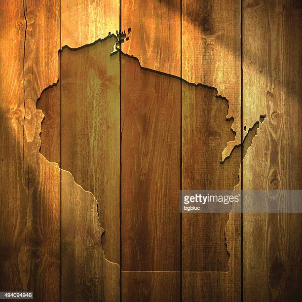 Wisconsin Map on lit Wooden Background