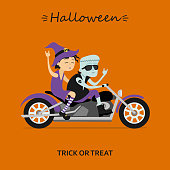 Witch and Frankenstein ride the motorcycle