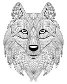 Wolf head in zentangle style. Adult antistress coloring page. Black and white hand drawn doodle for coloring book. Ethnic pattern, ornament