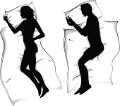 woman and men silhouettes lying in bed sleeping