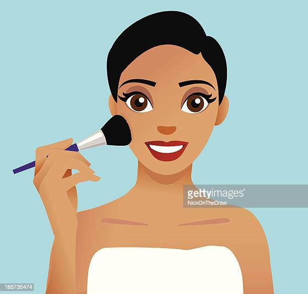 Woman applying cosmetics with a blusher brush