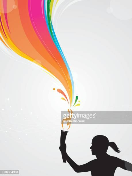 Woman athlete with torch