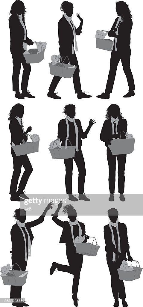 Woman carrying basket : stock illustration