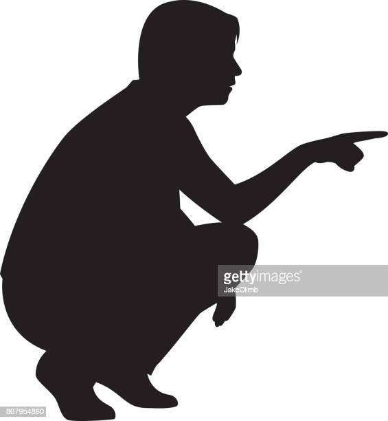 Femme accroupie pointant Silhouette
