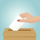 Woman drop a voting paper in the box
